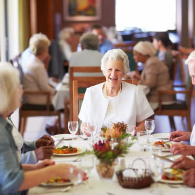 A woman enjoying the dining at Westminster Memory Care in Aiken, South Carolina