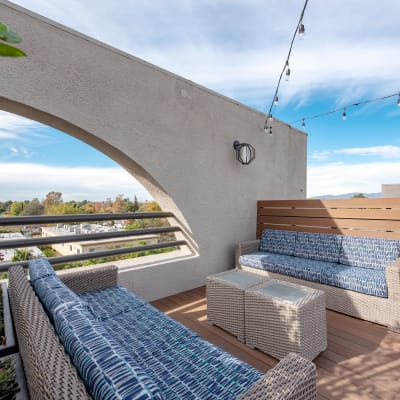 Modern couches on a balcony at Vue at Laurel Canyon in Valley Village, California