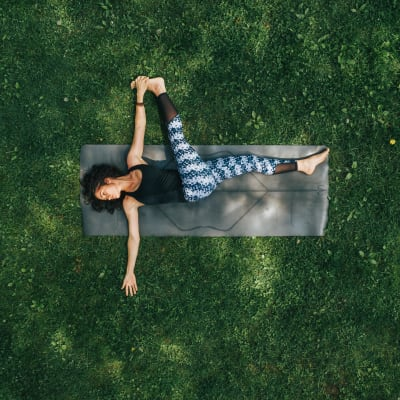 Resident doing outdoor yoga at a local park in Chicago, Illinois near Residences at 8 East Huron