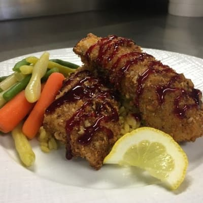 Pecan encrusted walleye with rice and vegetables available at First & Main of Bloomfield Township in Bloomfield Township, Michigan