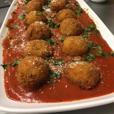 Stuffed Risotto balls with gruyere cheese and marinara sauce served at First & Main of Lewis Center in Lewis Center, Ohio