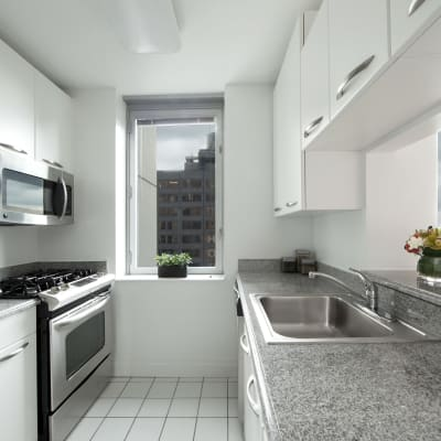 A kitchen with stainless-steel appliances at The Metropolis in New York, New York