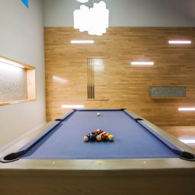 A clubhouse with a pool table at The Metropolis in New York, New York