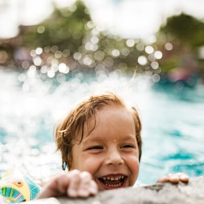 Child swimming in the pool at Lakeside Apartment Homes in Slidell, Louisiana
