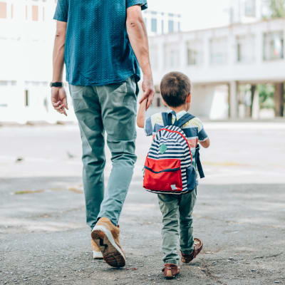 Resident walking his child to school near The Marquis Apartment Homes in New Orleans, Louisiana
