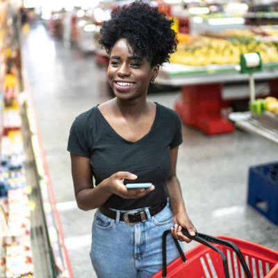 Resident shopping at a local grocery stores near The Marquis Apartment Homes in New Orleans, Louisiana