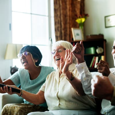 Group of residents cheering at Deer Crest Senior Living in Red Wing, Minnesota