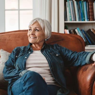 Resident sitting in a lounge chair inside York Gardens in Edina, Minnesota