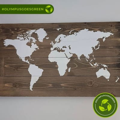 Map of the world painted in white on recycled wood