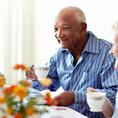 Resident man drinking coffee at Arbor Glen Senior Living in Lake Elmo, Minnesota
