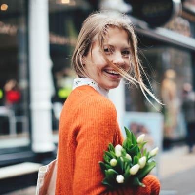 Resident carrying flowers near The Aeronaut in Weymouth, Massachusetts