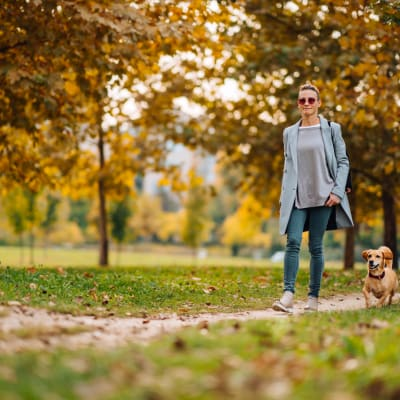 Resident walking her dog near Marquis on Pin Oak in Houston, Texas