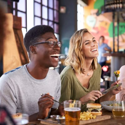Friends out at their favorite restaurant grabbing food and drinks near Main Street Apartments in Rockville, Maryland