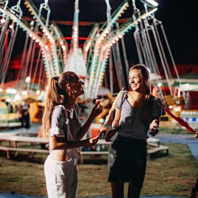 Residents at a carnival at Bellrock Summer Street in Houston, Texas