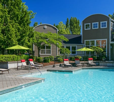 Swimming pool with a spacious sundeck at Center Pointe Apartment Homes in Beaverton, Oregon