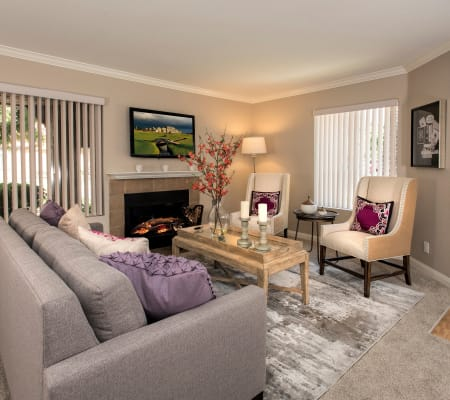 Spacious living room with a fireplace at Hidden Hills Condominium Rentals in Laguna Niguel, California