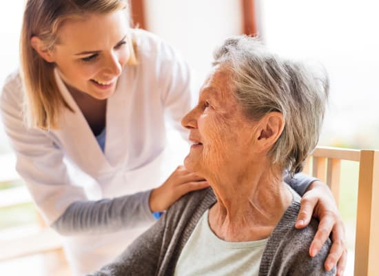 Nurse with resident at Westminster Memory Care in Aiken, South Carolina