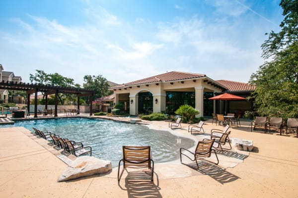 Resort-style swimming pool at Pecan Springs Apartments in San Antonio, TX