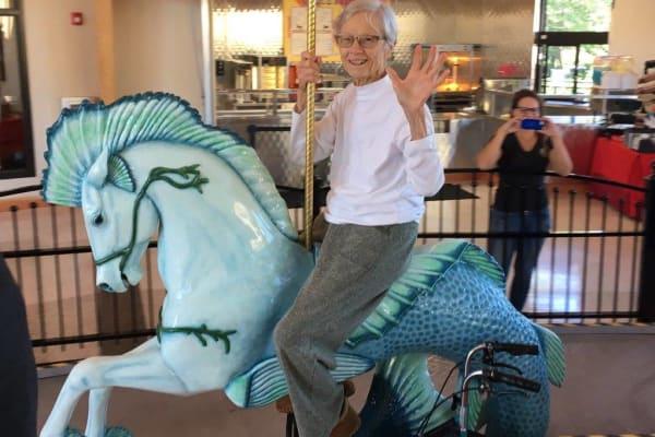 elderly woman on horse merry go round