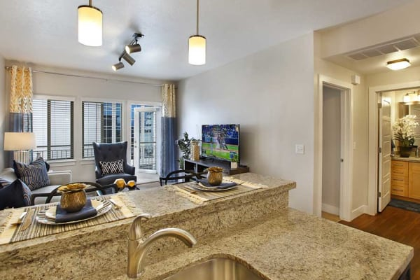 kitchen and living room at Liberty Crest Apartments