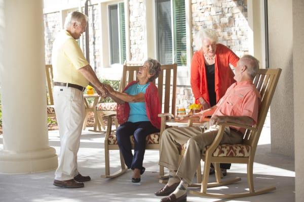 Senior residents enjoying covered seating outside