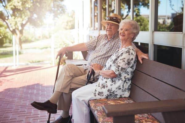 Couple doing paperwork at Waltonwood Reston - Coming Soon
