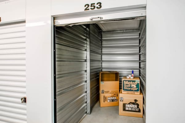 Open indoor unit with packages at Metro Self Storage in Sharon Hill, Pennsylvania