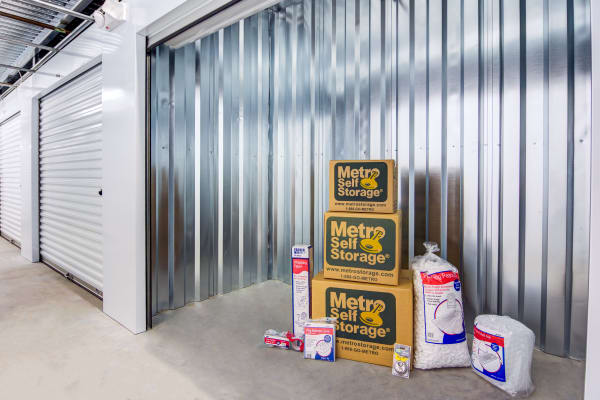 Open indoor unit with packages at Metro Self Storage in Conyers, Georgia
