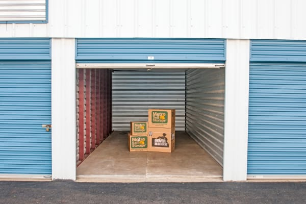 Open unit with packages at Metro Self Storage in Newtown, Pennsylvania