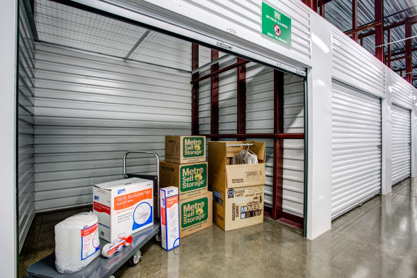 Open unit with packages at Metro Self Storage in Mundelein, Illinois