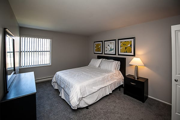 Bedroom view at Spice Tree Apartments including hardwood flooring and stainless steel appliances