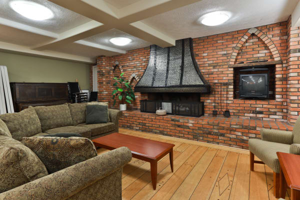 Beautiful fireplace at Fraser Tolmie Apartments in Victoria