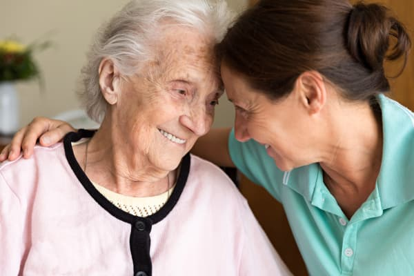 A caregiver and resident at Regency Park Senior Living, Inc.
