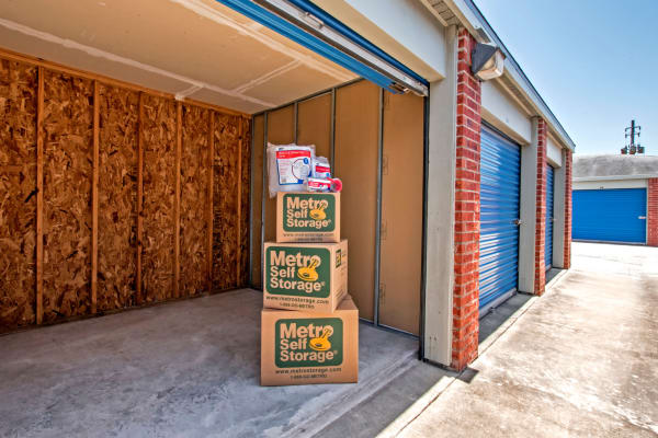 Open unit with packages inside at Metro Self Storage in Corpus Christi, Texas