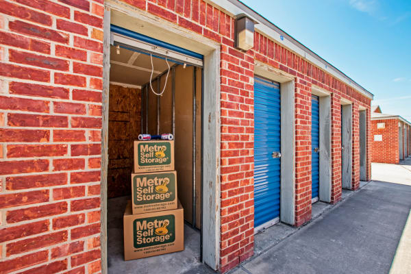 Open outdoor unit with packages at Metro Self Storage in Corpus Christi, Texas