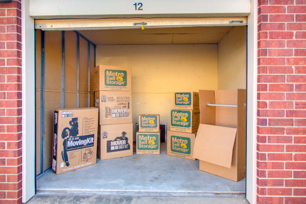 Open unit with packages at Metro Self Storage in Houston, Texas