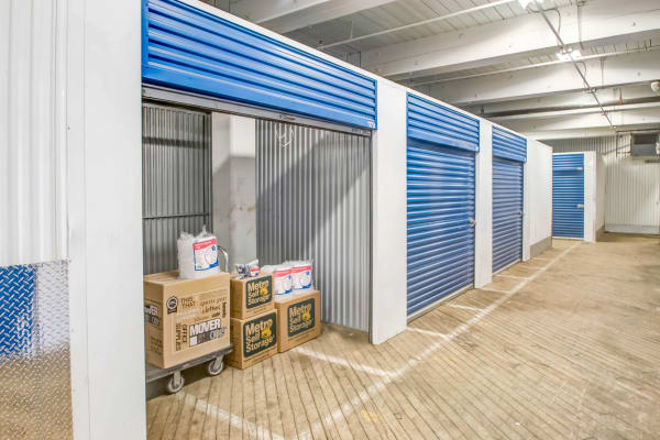 Open indoor unit with packages at Metro Self Storage in Philadelphia, Pennsylvania