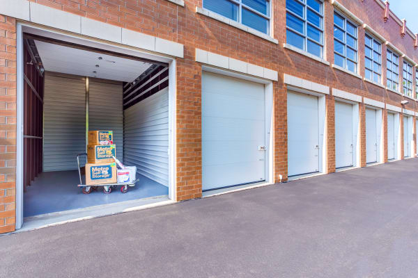Open exterior unit with packages at Metro Self Storage in Lake Bluff, Illinois