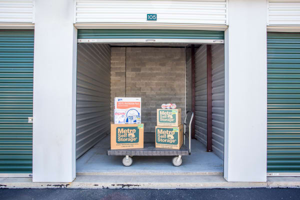Open unit with packages at Metro Self Storage in Lake Zurich, Illinois