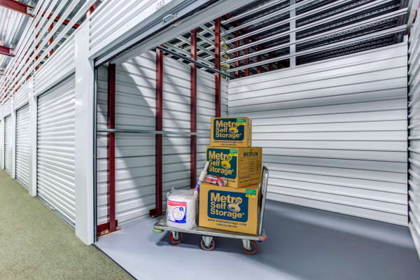 Open indoor unit with packages at Metro Self Storage in Lake Bluff, Illinois