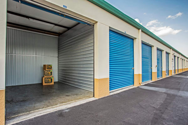 Open outdoor unit with packages at Metro Self Storage in Lehigh Acres, Florida