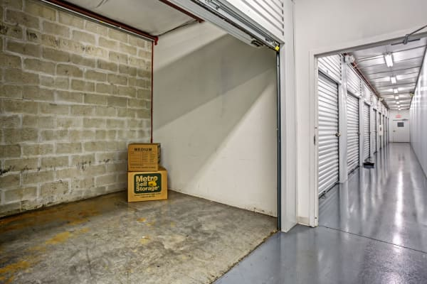 Open unit with packages at Metro Self Storage in Lehigh Acres, Florida