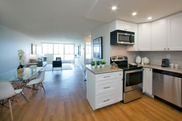 Open kitchen, dining and living area at Bristol Court in Mississauga, Ontario