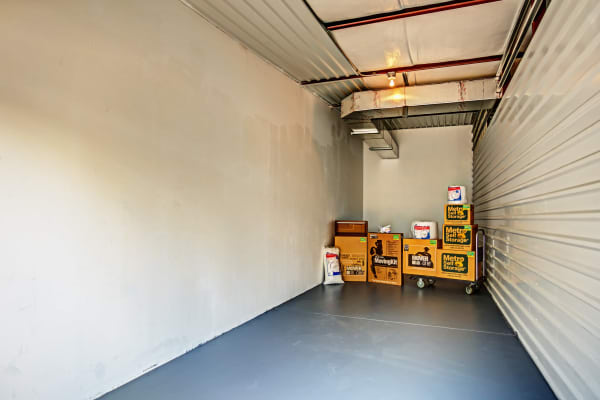 Open unit with pacakges at Metro Self Storage in Spring Hill, Florida