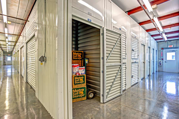 Open unit with packages at Metro Self Storage in Fort Myers, Florida