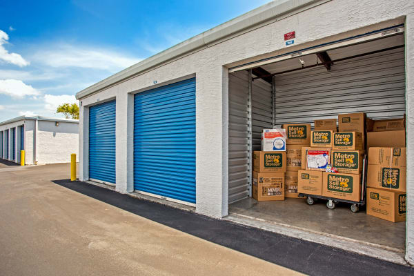 Open outdoor unit with packages at Metro Self Storage in Fort Myers, Florida
