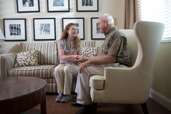 staff member talking with senior resident