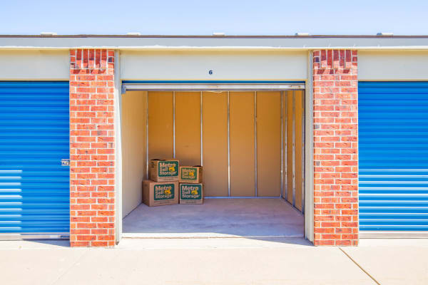 Outdoor open unit with packages at Metro Self Storage in Wichita, Kansas