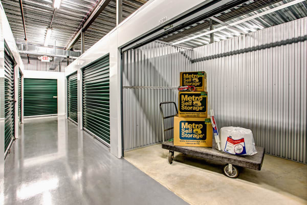 Open indoor unit with packages at Metro Self Storage in West Chicago, Illinois