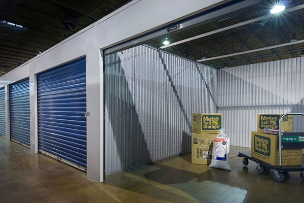 Open indoor unit with packages at Metro Self Storage in Chicago, Illinois